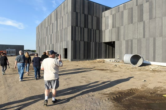 Members of the community start a tour of the new Sartell High School under construction Thursday, Sept. 6, in Sartell.