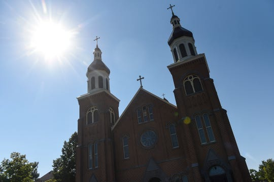 Bright sunlight outlines the Church of St. Mary Friday, Sept. 7, in Melrose. The church was heavily damaged by arson in March, 2016. A new church building is planned for a site nearby.