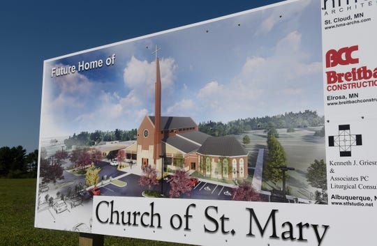 A sign is posted near the site of the new Church of St. Mary Friday, Sept. 7, in Melrose.