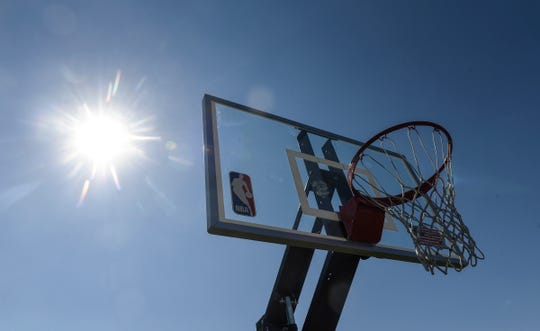 The sun sets behind new backboards at the basketball court at Northway Park Friday, Sept. 7, in St. Cloud.