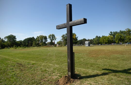 A large wooden cross marks the site of the baptismal font in the planned new Church of St. Mary Friday, Sept. 7, in Melrose.