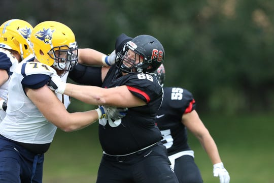 St. Cloud State defensive end Jake Schley (66) battles for position in a game against Augustana right tackle Cody Rofshus (74) on Sept. 23, 2017 at Husky Stadium. Schley had a career-best nine tackles in the Huskies' season-opening win over the University of Mary on Aug. 30.