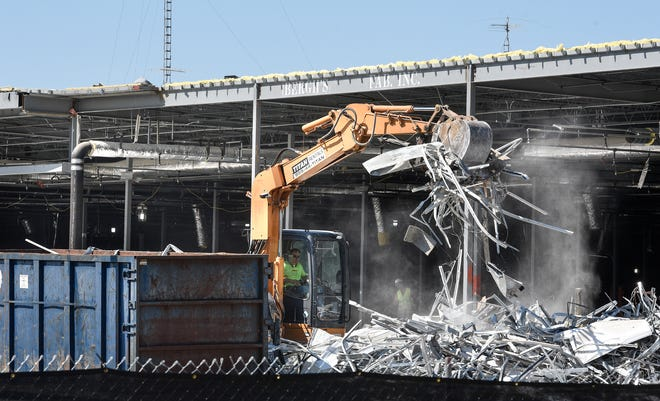 Crews remove materials during renovation work on the former Sears location at Crossroads Center Friday, Sept. 7, in St. Cloud.