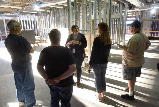 High school Principal Brenda Steve leads a tour for members of the community of the new Sartell High School Thursday, Sept. 6, in Sartell.