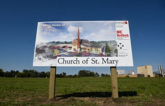 A sign includes an artist's rendition of the proposed Church of St. Mary Friday, Sept. 7, in Melrose.