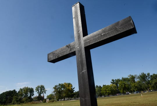 A large wooden cross marks the site where the baptismal font will be located in the planned new Church of St. Mary Friday, Sept. 7, in Melrose.