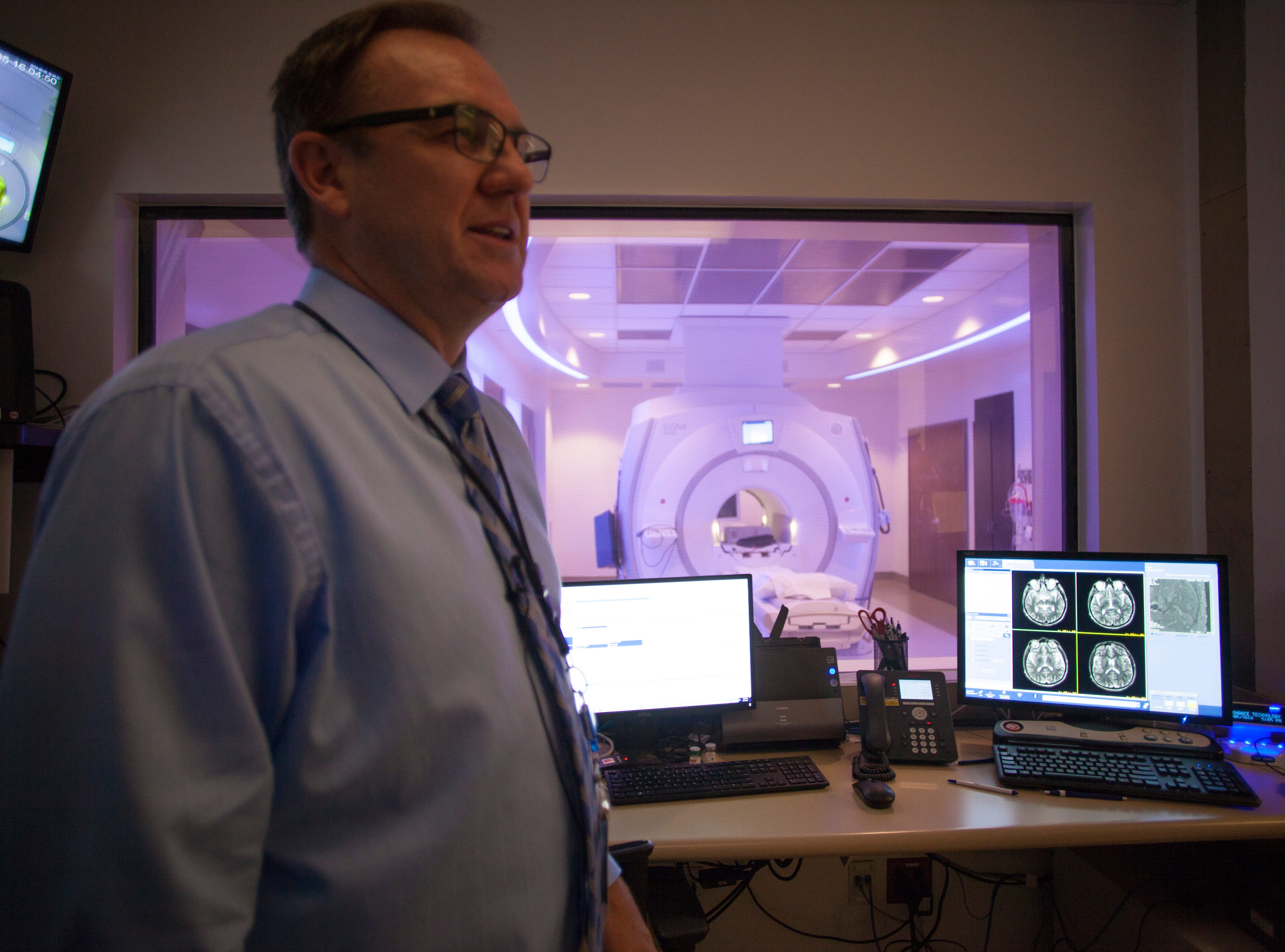 Darrell Hinton, Director of Imaging at IHC, demonstrates one of the MRI machines in the hospital and it's proximity to an operating room Wednesday, Sept. 5, 2018.