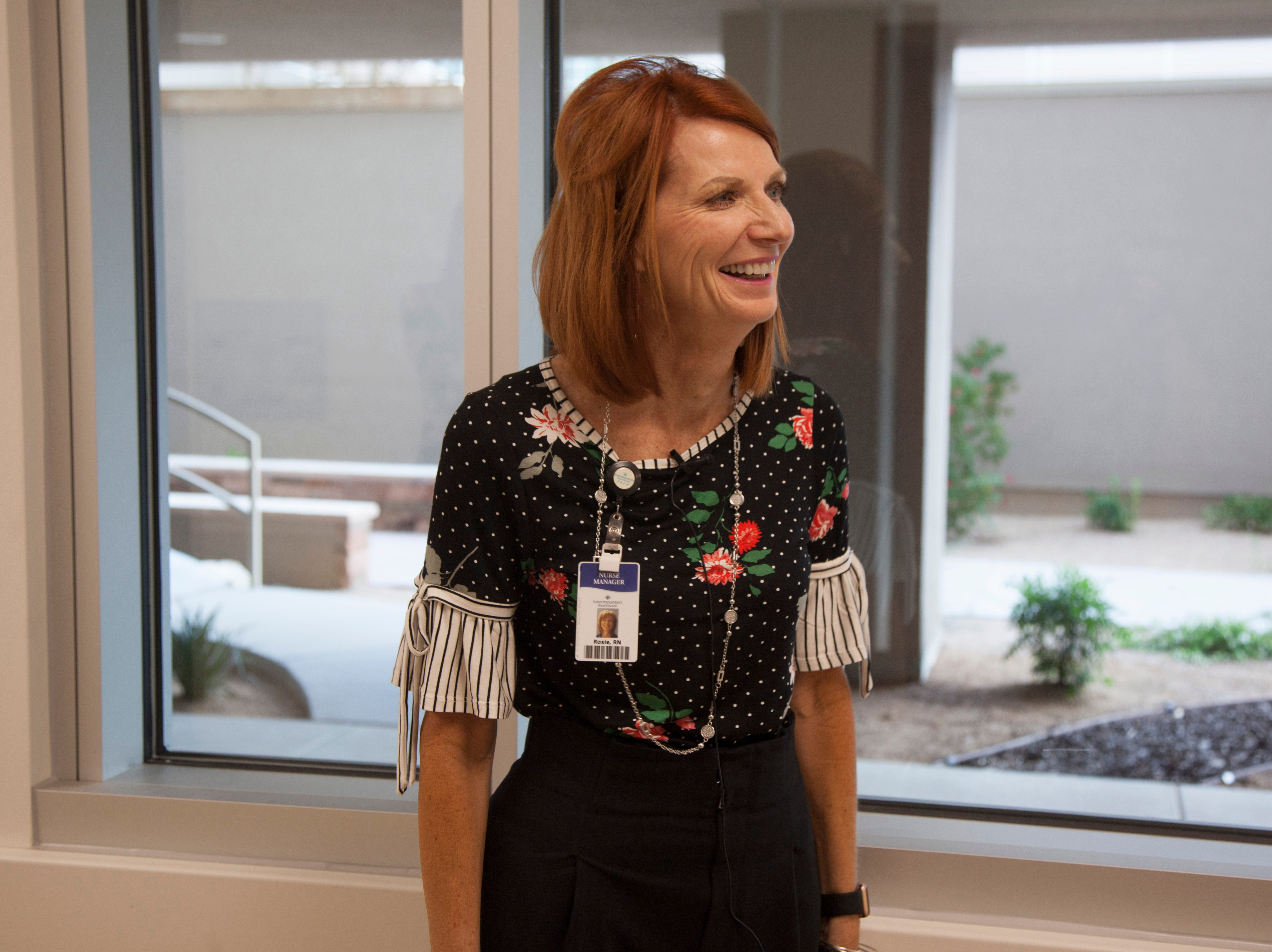 Roxanne Butterfield, Neural Rehabilitation Nurse Manager at IHC, discusses the garden and equipment available to patients Wednesday, Sept. 5, 2018.