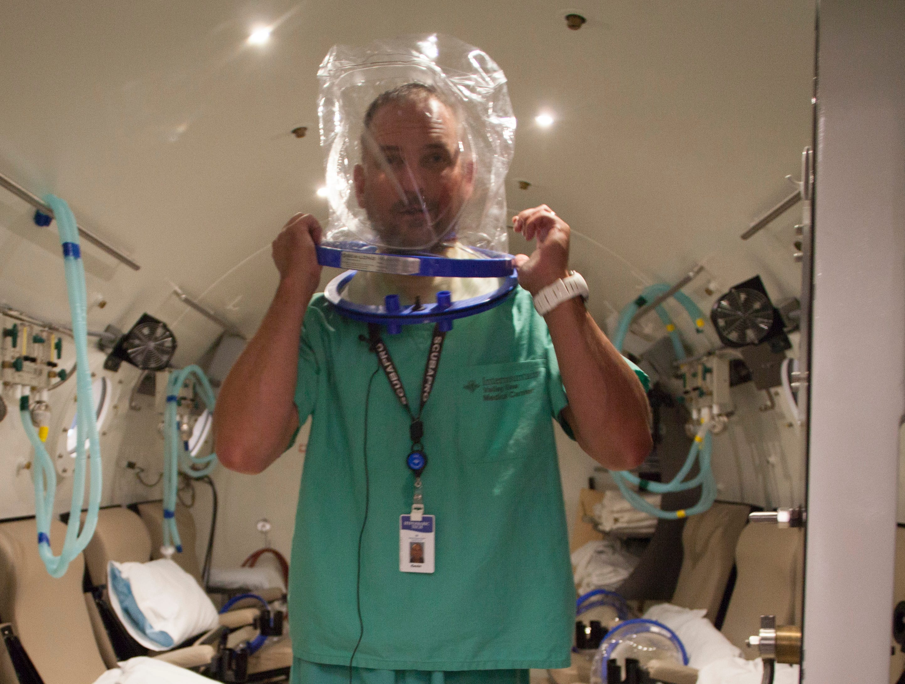 Kevin Dye, Hyperbaric Chamber Technologist at IHC, demonstrates the process patients experience when using the chamber Wednesday, Sept. 5, 2018.