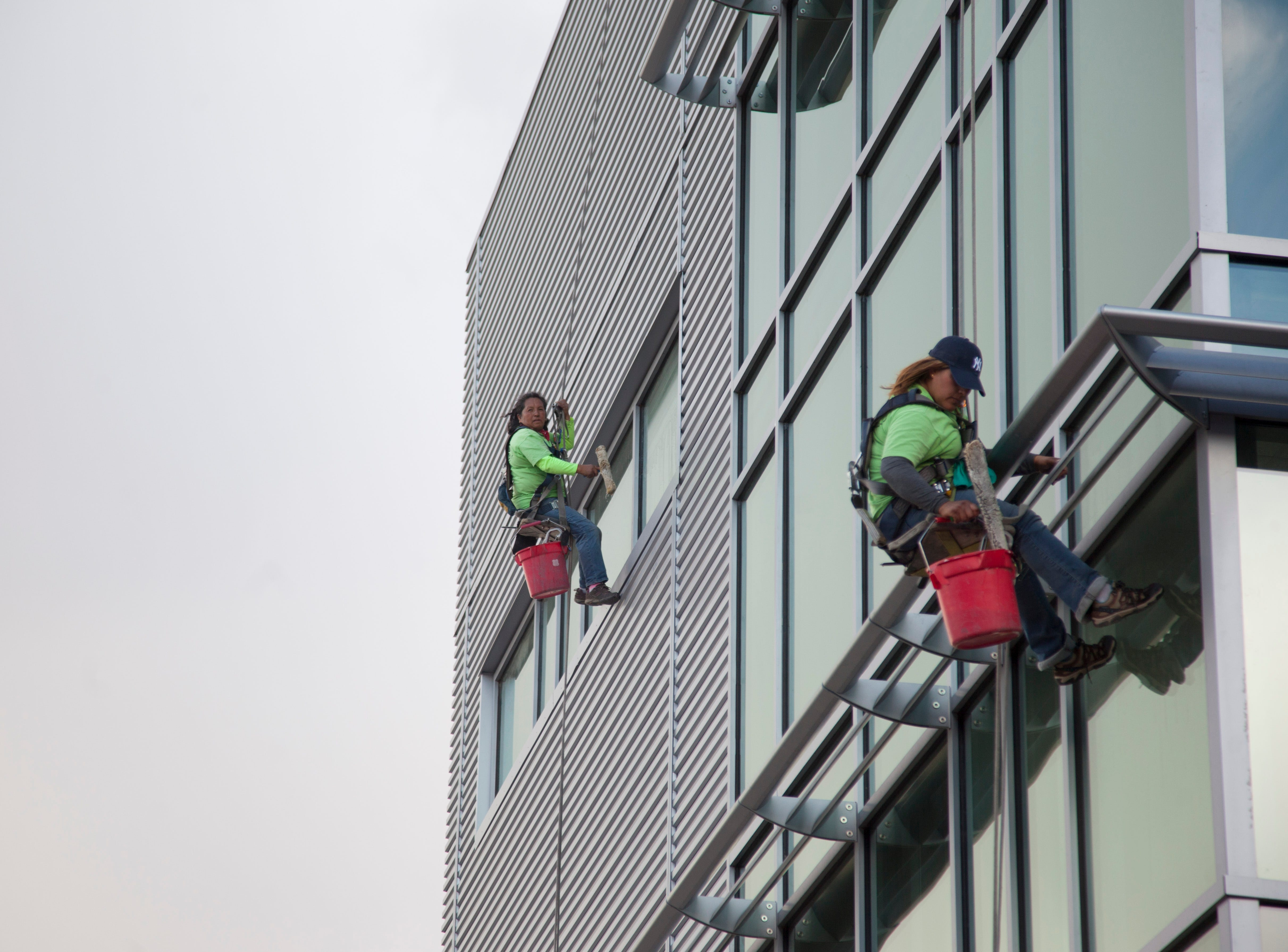Work including window washing continues at the Intermountain Cancer Center on Sept. 5, 2018.