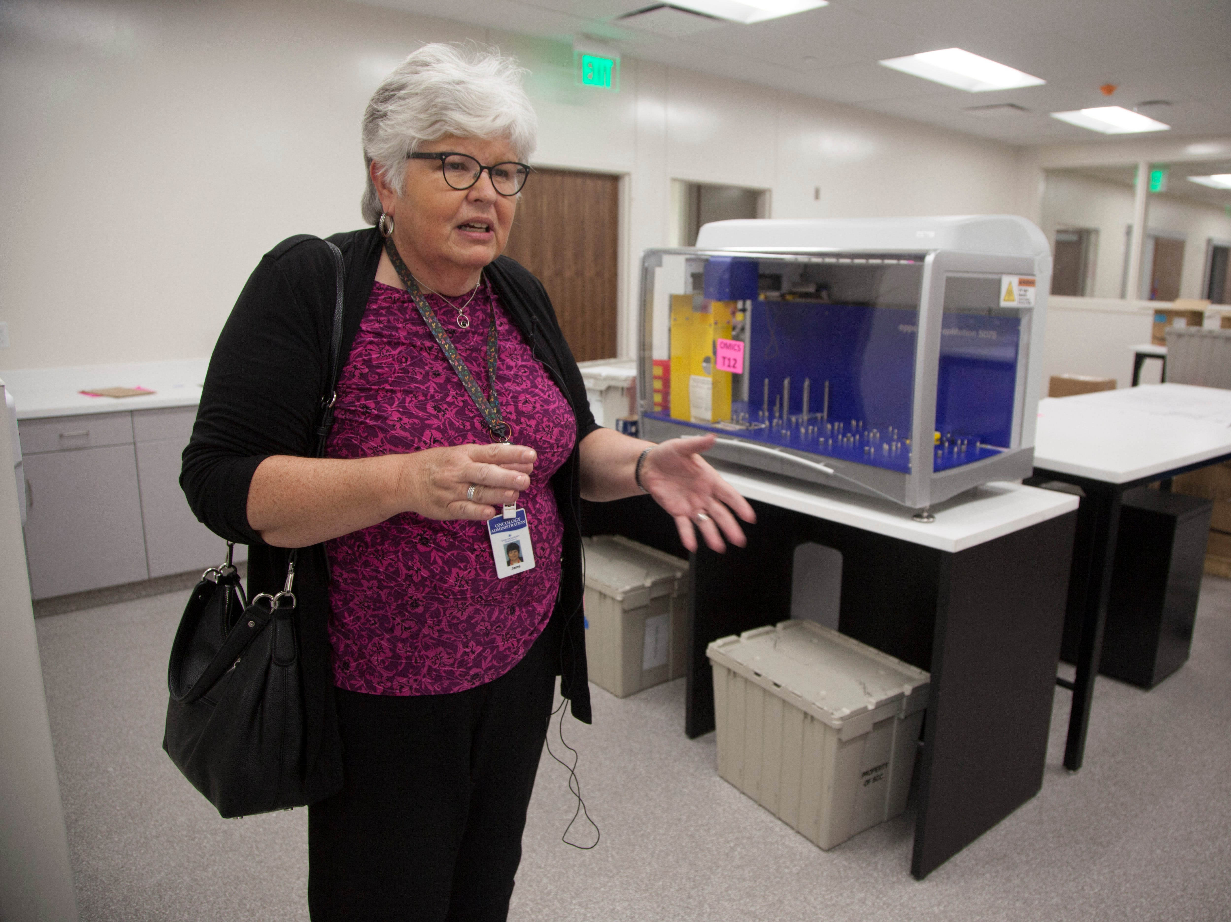 Jane Jensen, Program Director at the IHC Cancer Center, explains the technology and design implemented in the new center and their focus on patient connection and care Wednesday, Sept. 5, 2018.