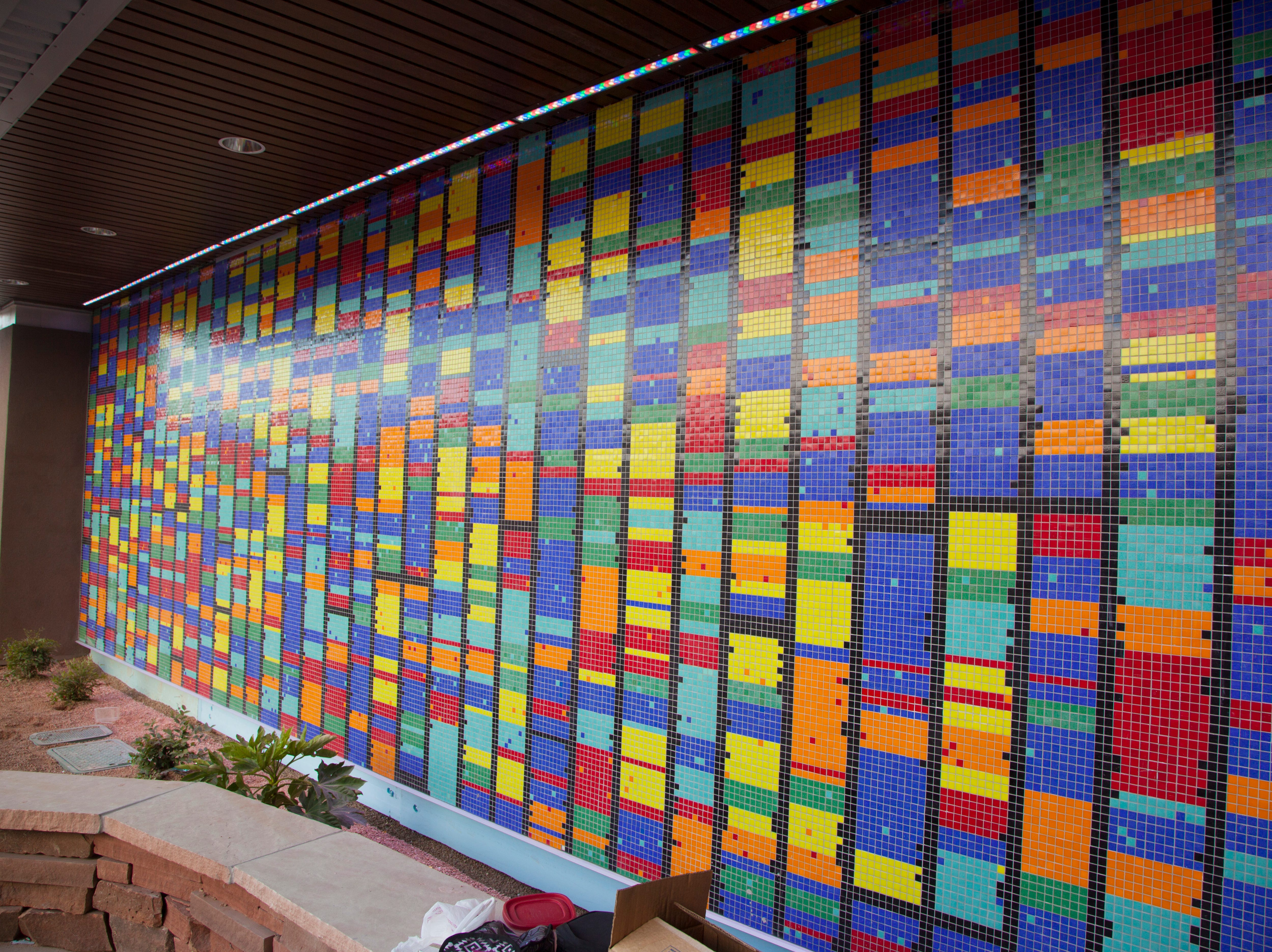 A mosaic on the side of the Intermountain Cancer Center of St. George was designed to resemble DNA sequences.