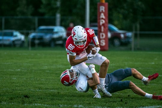 Neenah's Austin Hart tackles Lincoln's Sam Wallner during a football game between Wisconsin Rapids Lincoln and Neenah High School in Wisconsin Rapids, Wis., September 6, 2018.