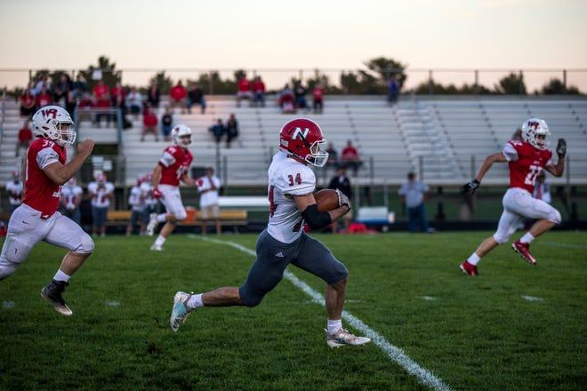 Neenah's Kaden Fritsch makes a run against Wisconsin Rapids on Friday in Wisconsin Rapids. Neenah improved to 4-0 and is ranked eighth in Division 1 in the latest AP state football poll.