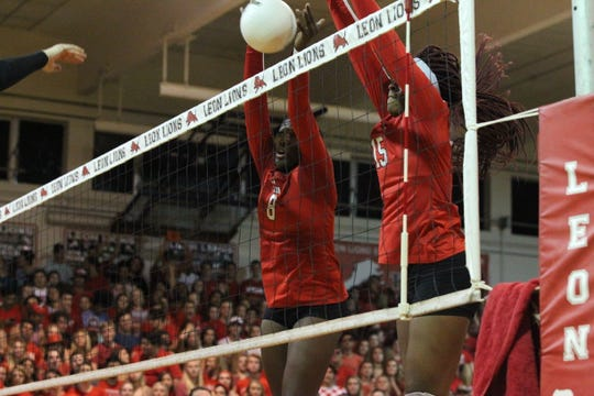 Leon's Makayla Washington and A'Nylah Cobb team up for a block as Leon beat Chiles 3-0 on Thursday night in a District 2-8A volleyball game.
