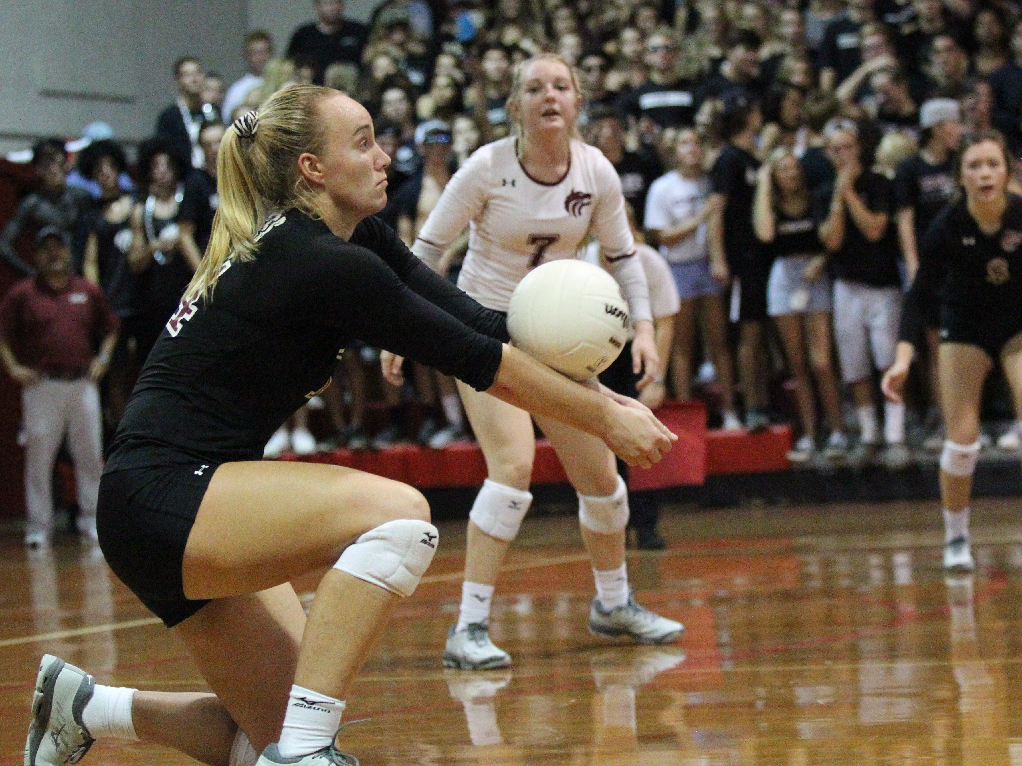 Chiles' Aly Freeland receives serve as Leon beat Chiles 3-0 on Thursday night in a District 2-8A volleyball game.