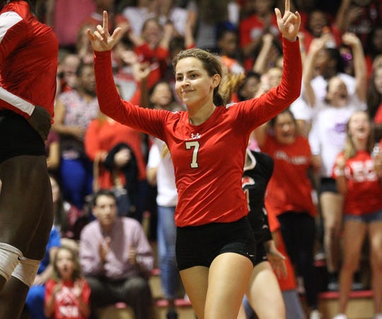 Leon's Kayleigh Kellogg reacts to scoring a point as Leon beat Chiles 3-0 on Thursday night in a District 2-8A volleyball game.