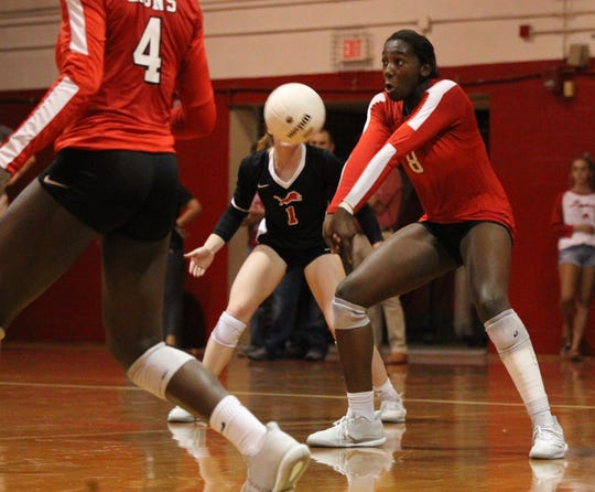 Leon's Makayla Washington receives a serve as Leon beat Chiles 3-0 on Thursday night in a District 2-8A volleyball game.