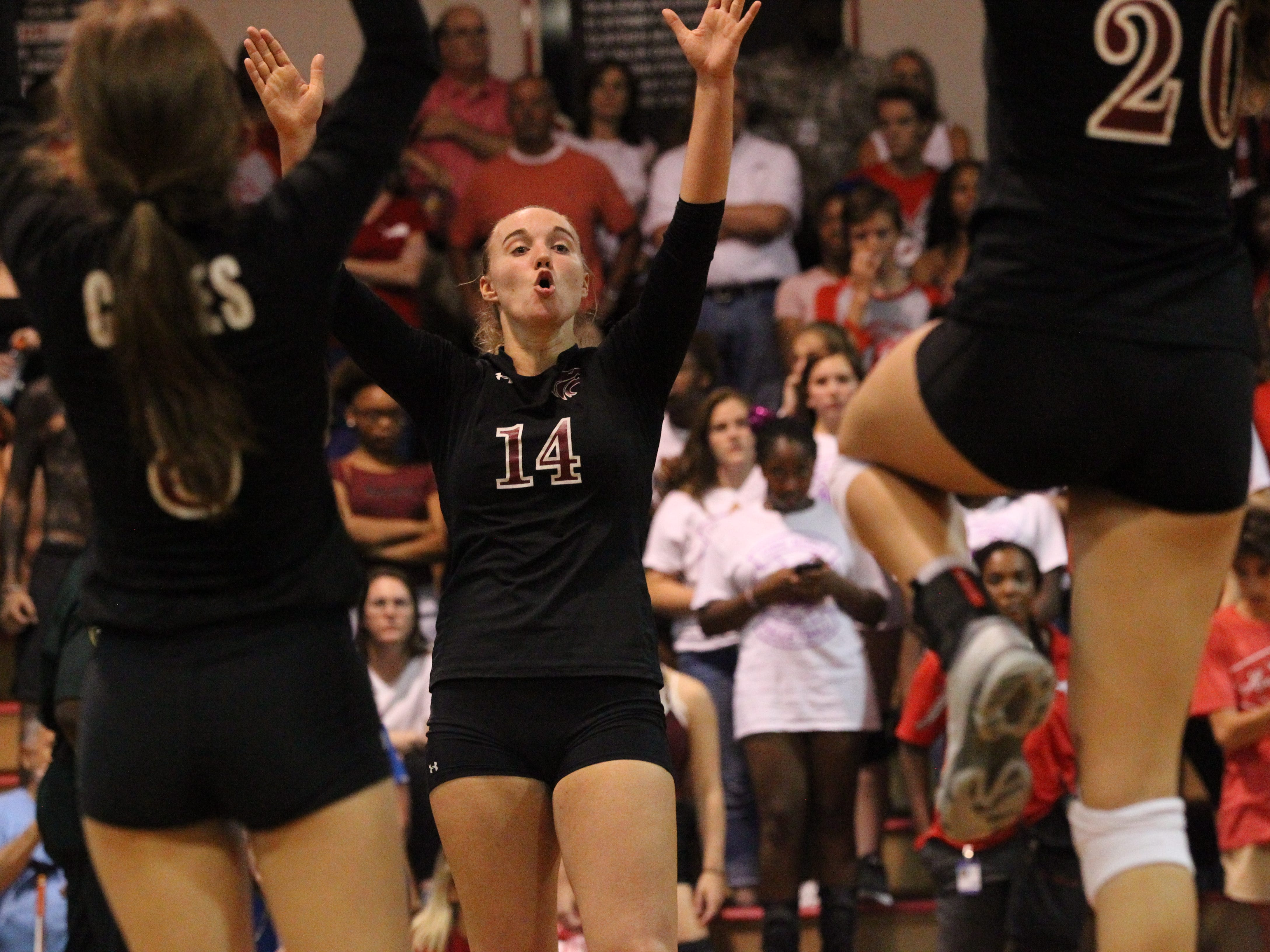 Chiles' Aly Freeland reacts to scoring a point as Leon beat Chiles 3-0 on Thursday night in a District 2-8A volleyball game.