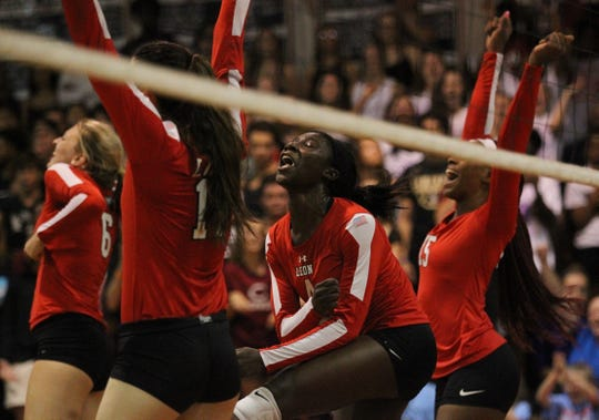 Leon's Shania Cromartie reacts to scoring a point as Leon beat Chiles 3-0 on Thursday night in a District 2-8A volleyball game.