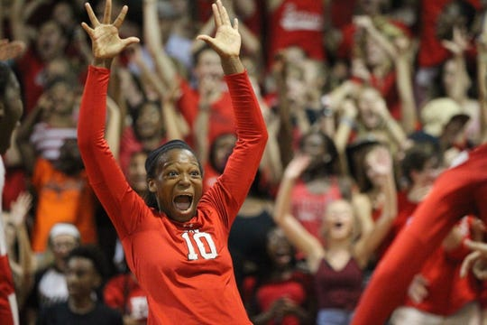 Leon's Alexa Washington reacts to scoring a point as Leon beat Chiles 3-0 on Thursday night in a District 2-8A volleyball game.