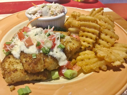 Magic Oyster's  Parmesan Crusted Cod was two portions of cod were pan-seared, topped with tomatoes, scallions, shredded Parmesan and a dill ranch sauce. The sides were coleslaw and waffle fries.
