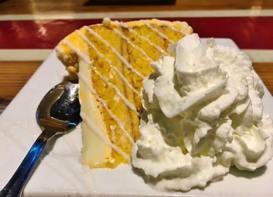 Magic Oyster's Sunrise Florida Orange Cake with orange sherbet and thick icing.