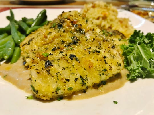 Magic Oyster's herb crusted corvina was a tender, mellow fish lightly toasted in panko and scented with dill, tarragon, parsley and basil served atop a light mushroom ragout. Rice pilaf and green beans rounded out the meal.