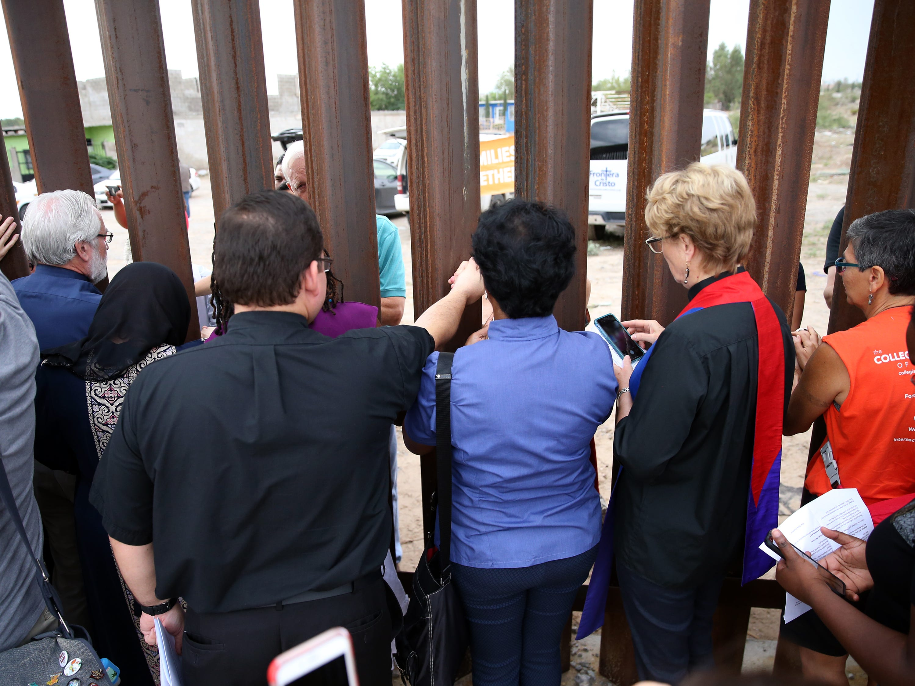 An interfaith gathering along both sides of the border fence Friday in Sunland Park, N.M.