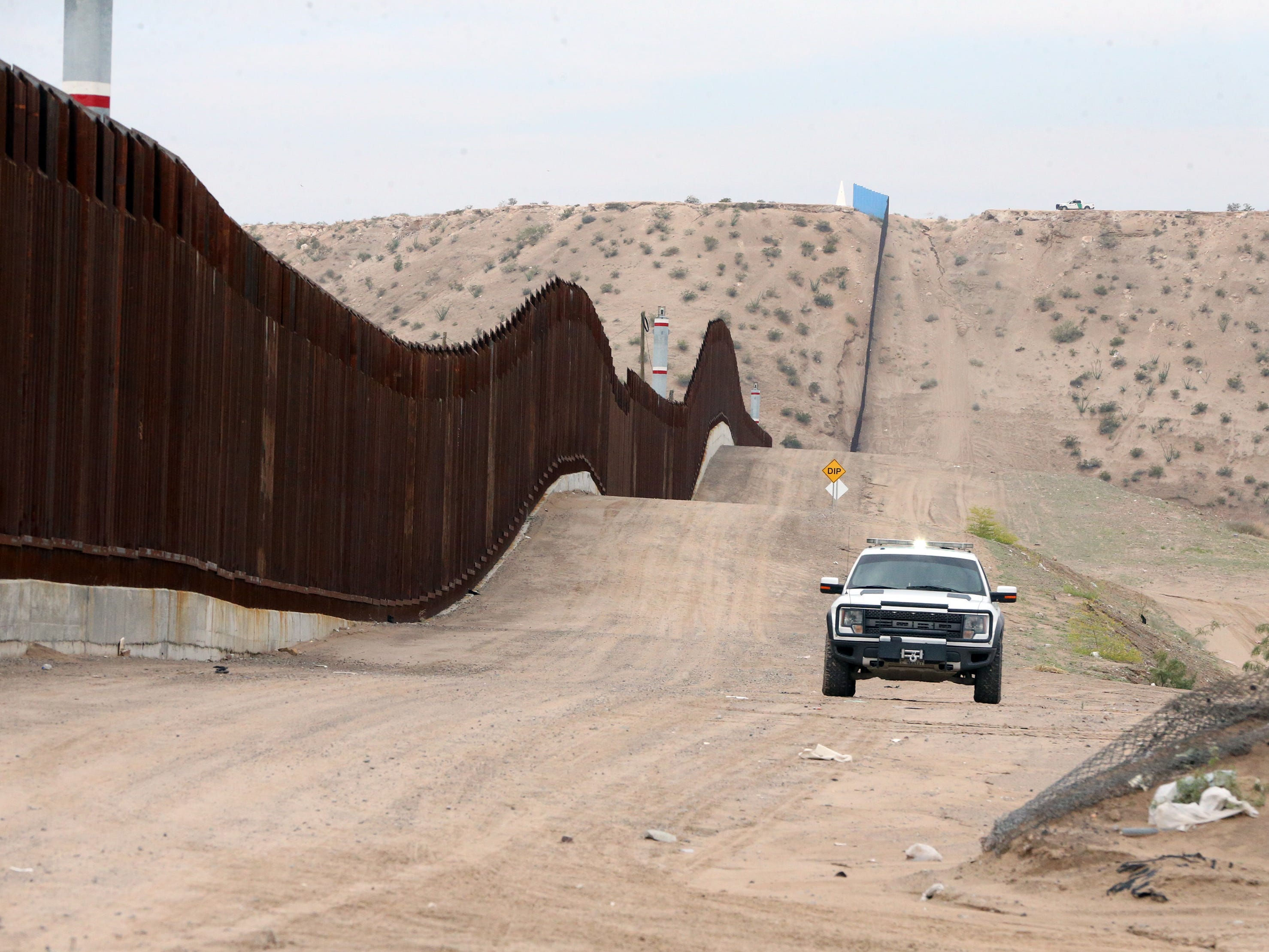 A U.S. Border Patrol vehicle parked at a distance from where a gathering of interfaith groups took place at the border fence in Sunland Park, N.M. Friday.