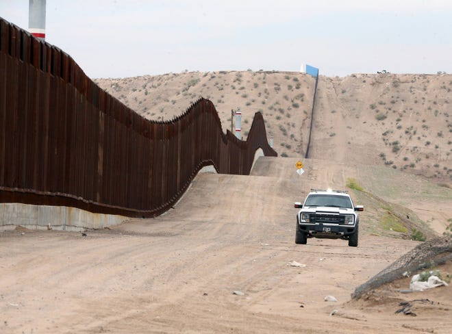 A U.S. Border Patrol vehicle is parked at the border fence in Sunland Park, N.M.