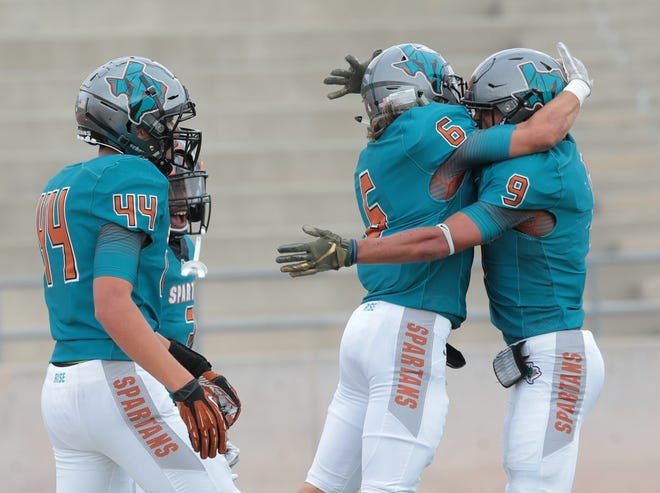 Pebble Hills toughs out a win against Midland High School Thursday at the SAC. Pebble Hills tops Midland 42-38.