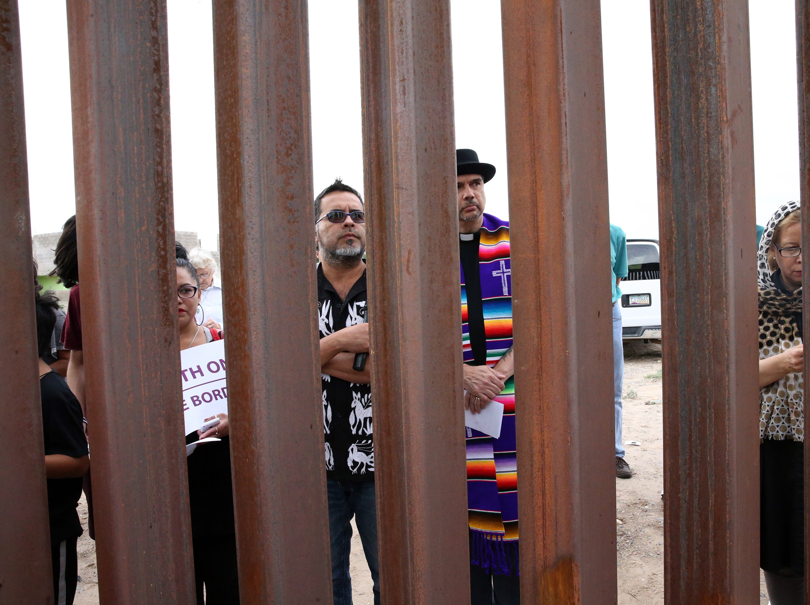 An interfaith group gathered on the Mexican side of the border fence for a prayer vigil Friday.