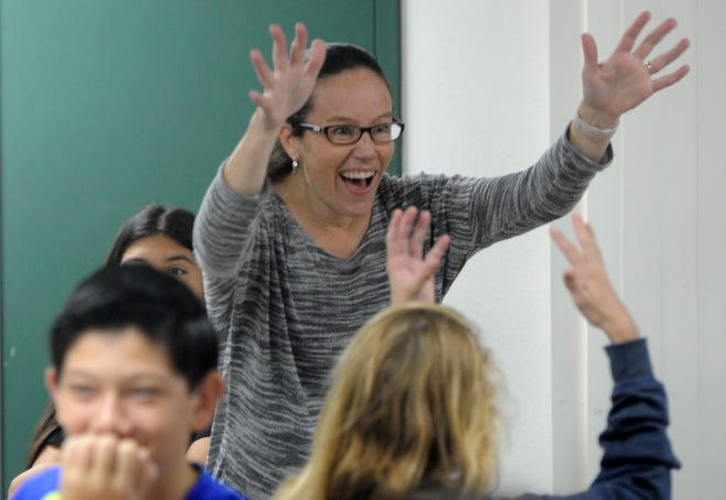 Danielle Bowler, an American Sign Language teacher at Moorpark High School, plays words games with her students. The school is offering American Sign Language for the first time.