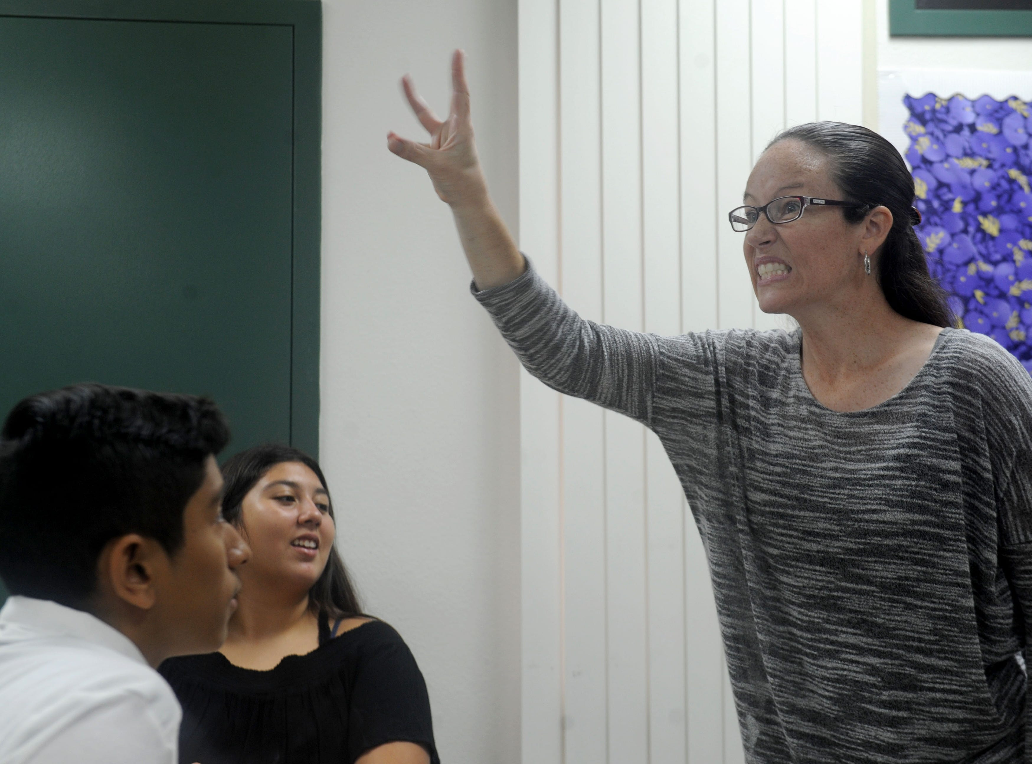 From left, freshmen Francisco Soto and Natalie Villalobos look at Danielle Bowler, who teaches American Sign Language at Moorpark High School. The school added the class after students requested it.