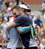 Mike Bryan, left, and Jack Sock embrace after winning the men's doubles title at the U.S. Open on Friday in New York.