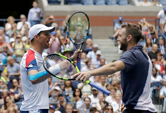 Mike Bryan, left, and Jack Sock start their celebration after winning the men's doubles championship at the U.S. Open in New York on Friday.