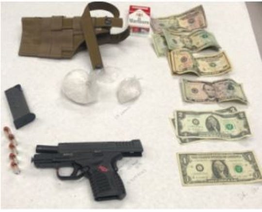Oxnard police confiscated a gun, drugs and cash during an arrest Thursday night.