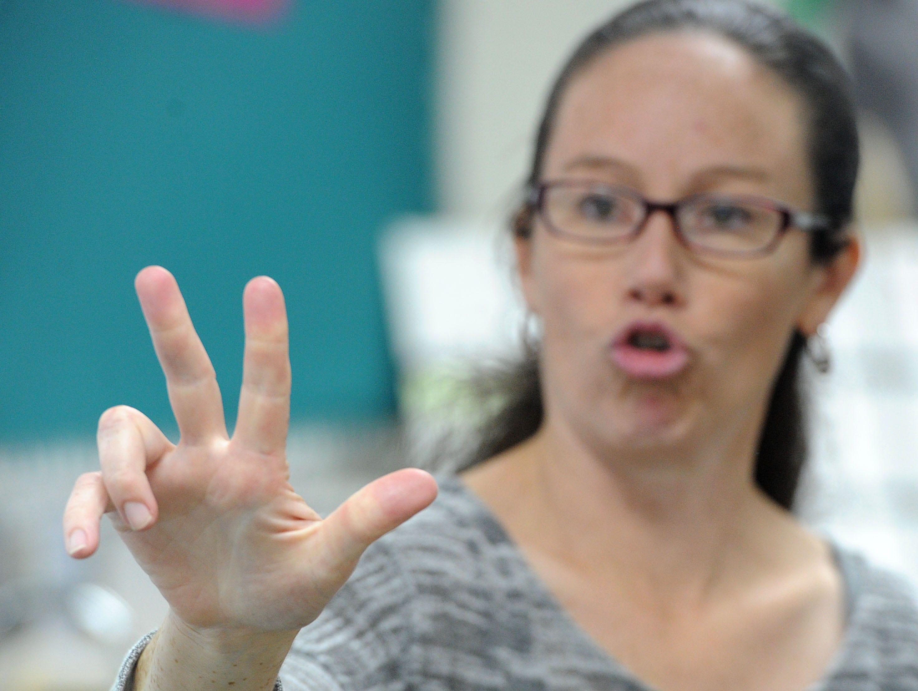 Danielle Bowler, an American Sign Language teacher at Moorpark High School signs to her students. Bowler is deaf and teaches alongside an interpreter.