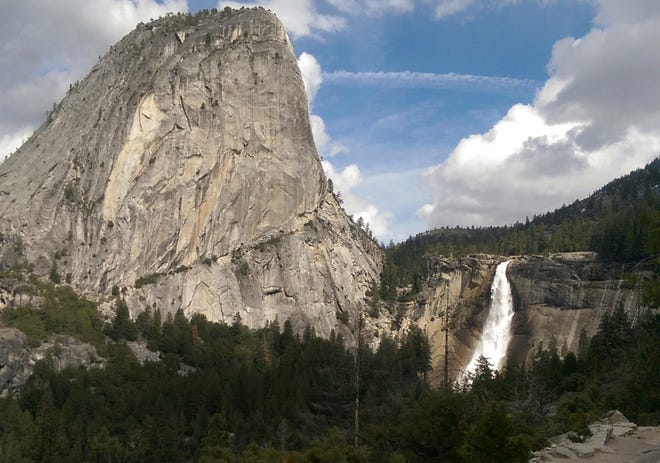 In this March 28, 2016, file photo provided by the National Park Service, water flows over the Nevada Fall near Liberty Cap as seen from the John Muir Trail in Yosemite National Park.