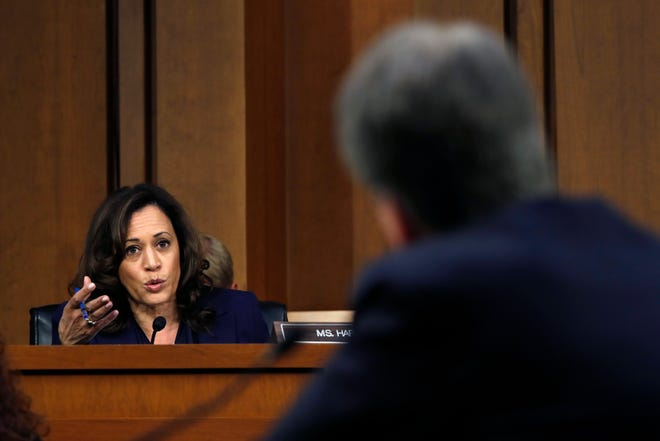 Sen. Kamala Harris, D-Calif., left, questions President Donald Trump's Supreme Court nominee, Brett Kavanaugh, in the evening of the second day of his Senate Judiciary Committee confirmation hearing Wednesday in Washington.