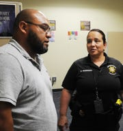 Jaime Perez, a youth advocate, talks to Bonique Rodriguez, a probation officer with the Ventura County Probation Agency at the Keeping Engaged Youth Supported center in Oxnard. The new center helps Ventura County youths on probation with job counseling, meals, adult mentoring and instruction in such life skills as how to make wise decisions.