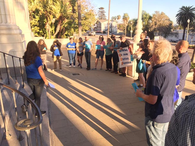 Members of Showing Up for Racial Justice with CAUSE before a Ventura City Council meeting in October to support district elections. Ventura, which has a population greater than a third Latino, has not had a non-white council member in recent history.