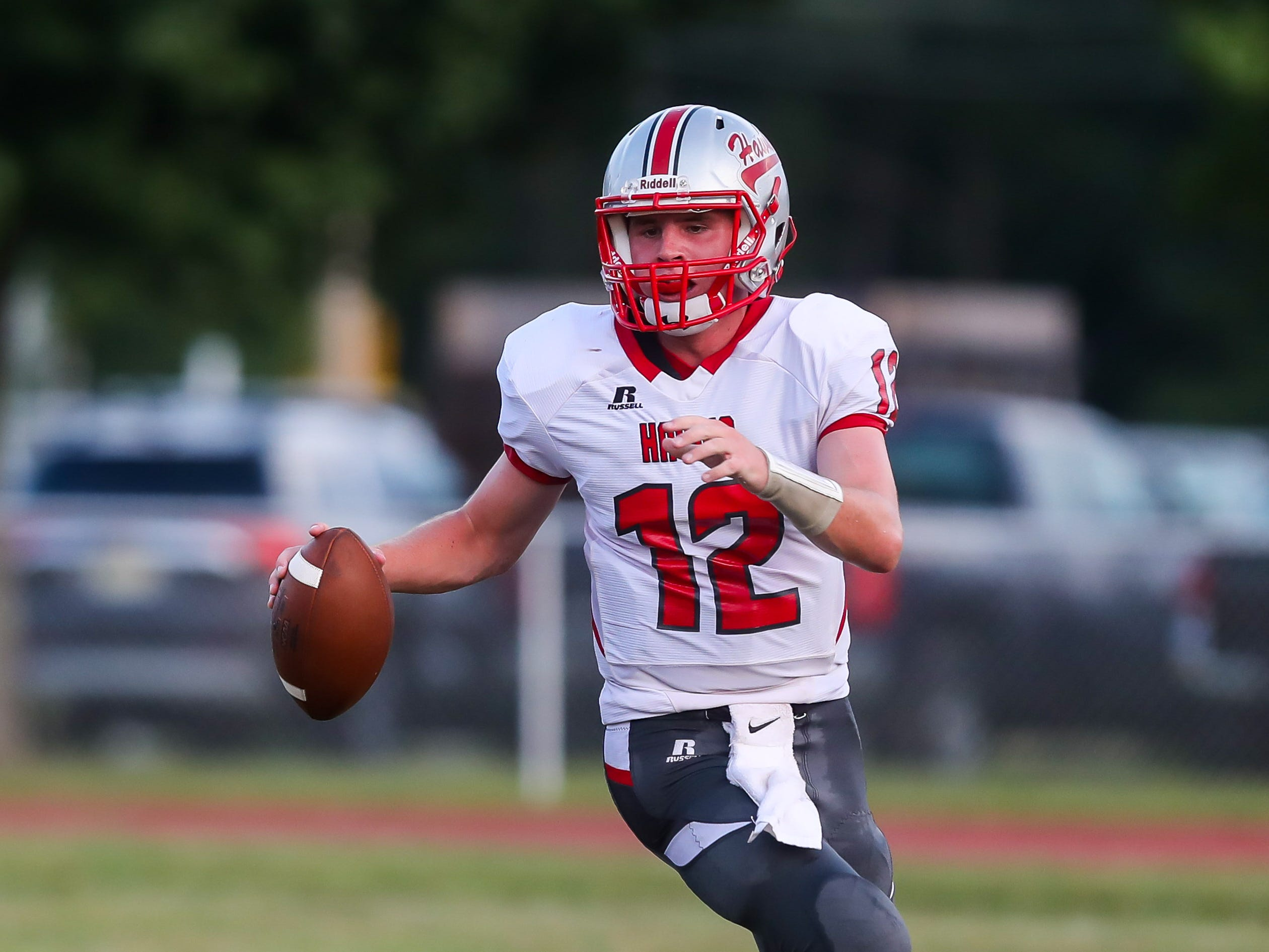 Haddon Township quarterback Nate Cossaboon runs the ball during Friday's football game between Haddon Township and Buena, played at Buena High School on September 7, 2018.