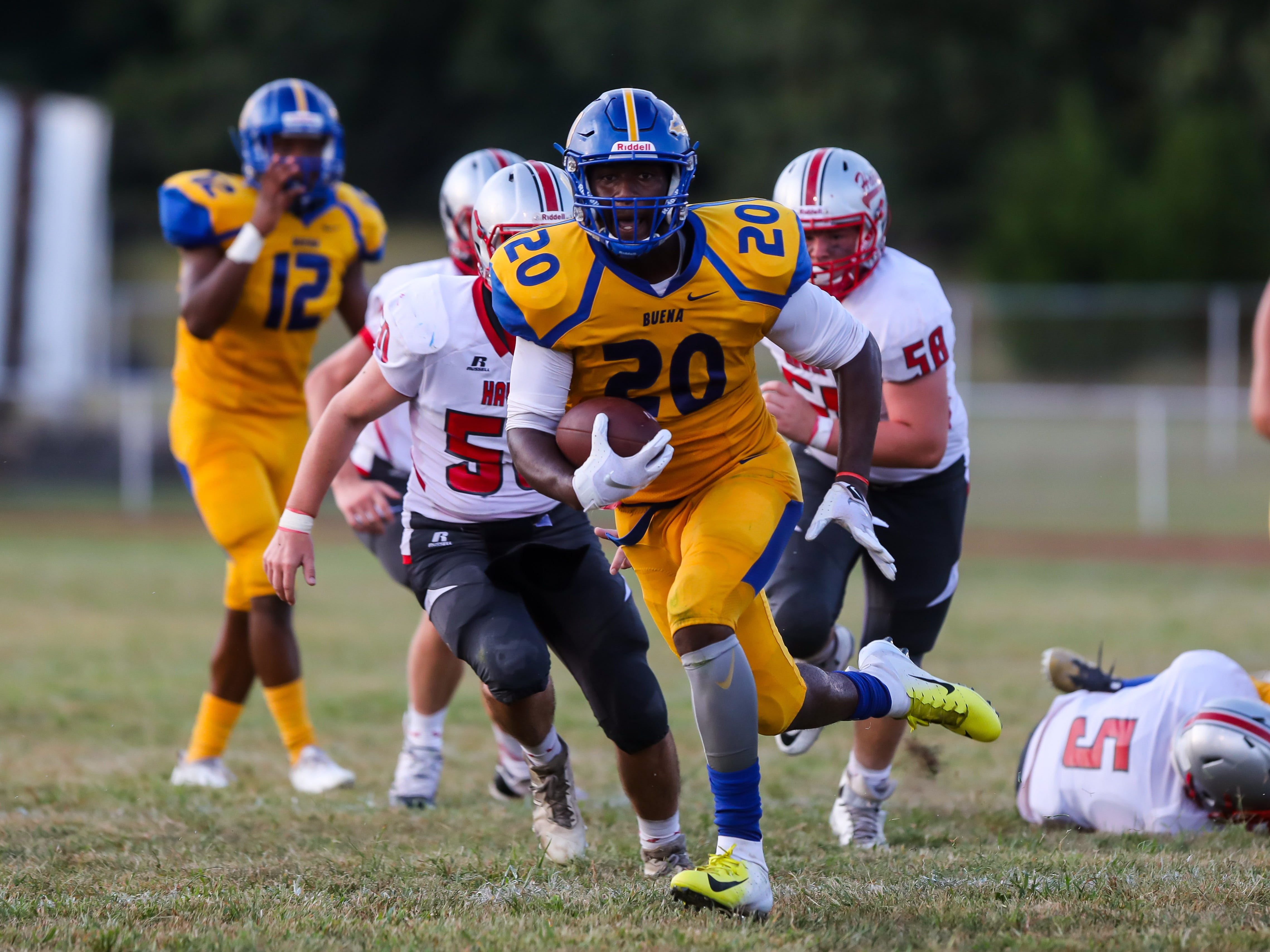 Buena's Byron Spellman runs for a 48 yard touchdown in the first quarter of Friday night's football game between Buena and Haddon Township at Buena High School on September 7, 2018.