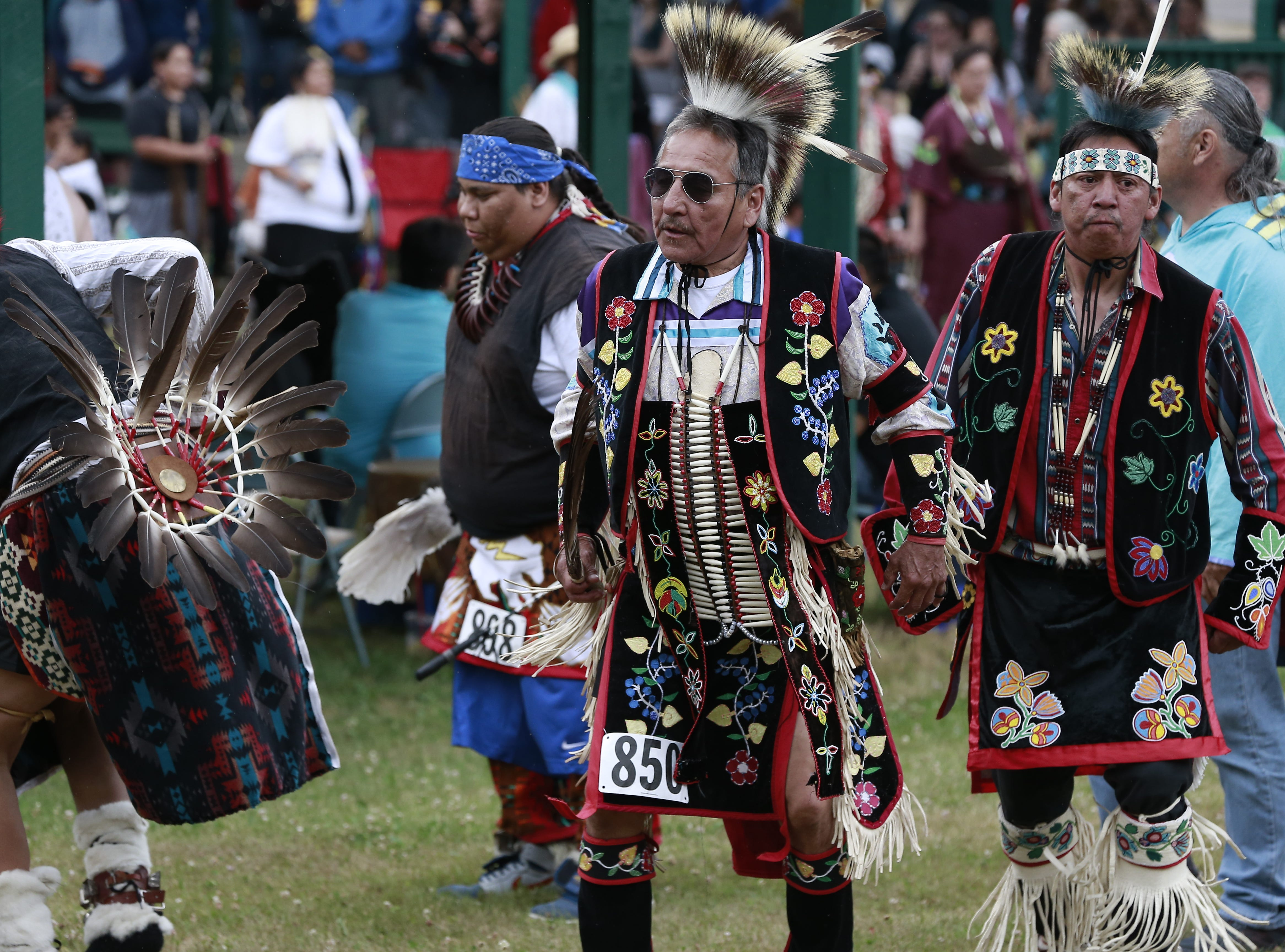 Native Americans from various tribes gather Friday, July 20, 2018, to celebrate the Honor the Earth Pow-wow event at LCO School in Hayward, Wis.