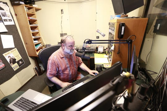 Program director Jeffrey Jones, of Hayward, runs his radio shows Friday, July 20, 2018, at WOJB radio station in Hayward, Wis.