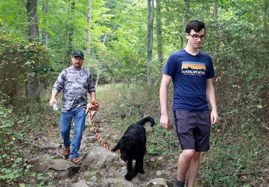 Dylan Frawley, right, and Ron Kirk along with Axel walk the trail of Hi Tor State Park in New City on Sept. 7, 2018, where they helped rescue an injury hiker.