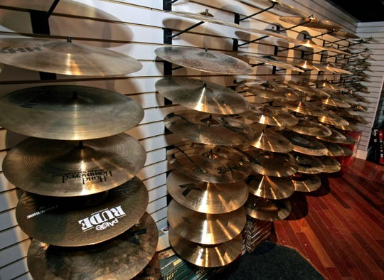 Cymbals line the wall at Alto Music's new location on Route 59 in Airmont in an April 19, 2010, photo.
