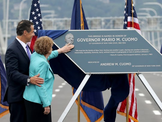 Matilda Cuomo rubs the face of her late husband, Mario, after Gov. Andrew Cuomo, former Secretary of State Hillary Rodham Clinton and Joanne M. Mahoney unveiled the plaque Friday during the grand opening of the second span of the Gov. Mario M. Cuomo Bridge.